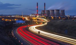 Ferrybridge Power Station in Yorkshire and a dual carriageway. Ferrybridge Power station in Yorkshire,UK and light trails on a dual carriageway stock photos