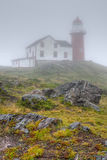 Ferryland lighthouse in fog Royalty Free Stock Image