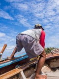 Ferryman and blue sky. Ferryman on the boat and blue sky Stock Photography