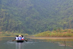 Ferrymen are taking tourists to visit the Trang An Eco-Tourism Complex, a complex beauty - landscapes called as an outdoor geologi Stock Image