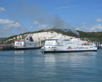 Ferrys at Dover, England. DOVER, ENGLAND, MAY 13 2015: View of the Port of Dover and a docking ferry. MyFerryLink is an English Channel ferry company which began Royalty Free Stock Image