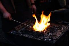 Fers dans le feu Photographie stock