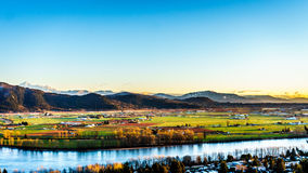 The fertile farmland of the Fraser Valley in British Columbia. South of the Fraser River with Mount Baker in the distant background behind Sumas Mountain from royalty free stock image