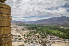 Fertile floor of river Indus floodplain contrasts with surroundings. View looking east from Thiksay Monastery of Thiksay village, the river Indus and the fertile stock image