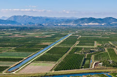 Fertile valley with crop fields. Beautiful Neretva valley in southern Croatia with numerous crop fields and hills in distance Royalty Free Stock Photo