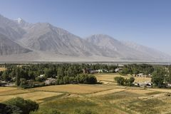Fertile Wakhan Valley near Vrang in Tajikistan. The mountains in the background are the Hindu Kush in Afghanistan. Central asia stock photo