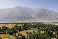 Fertile Wakhan Valley near Vrang in Tajikistan. The mountains in the background are the Hindu Kush in Afghanistan. Central asia stock images
