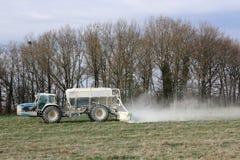 Fertilising winter pastures. A farmer fertilises his pastures during winter to improve spring grazing Stock Photo