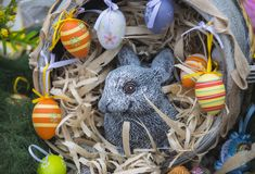 Fertility, abundance, new life symbol. Easter bunny and eggs in nest, spring. Easter decoration concept. Happy easter day. Spring holidays celebration royalty free stock photos