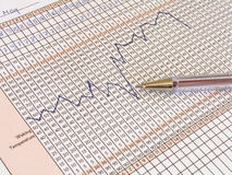 Fertility chart. With a temperature graph and a pen stock photo