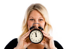 Fertility Clock is Ticking!. Blond woman holding a clock to signify the fertility / biological clock for woman concept royalty free stock images