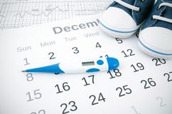 Fertility concept with thermometer on calendar Royalty Free Stock Photography