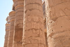 Fertility god Min, producer harvests. Fertility god Min. The image on the columns of the temple in Luxor Royalty Free Stock Photography