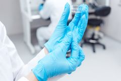 Fertility lab with technician holding tools for fertilizing human eggs. Showing petri dish Royalty Free Stock Photography