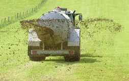 Fertilization with liquid manure on meadow. Fertilization with liquid manure in Bavaria, Germany Stock Photo
