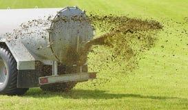 Fertilization with liquid manure on meadow. Fertilization with liquid manure in Bavaria, Germany Stock Photo