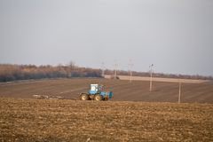 Fertilize ground. Farming series: plough up to field, fertilize ground royalty free stock images