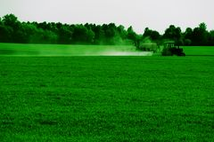 Fertilizer machine. (agricultural landscape in green colors Royalty Free Stock Images