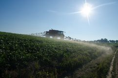 Fertilizer machine on the field stock photos