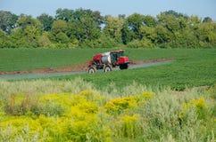 Fertilizer machine on the field royalty free stock photos