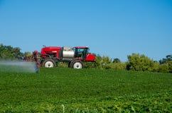 Fertilizer machine on the field royalty free stock photo