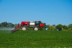 Fertilizer machine on the field stock image