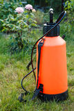 Fertilizer pesticide garden sprayer on green grass Stock Photography