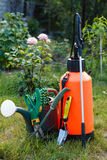 Fertilizer pesticide garden sprayer, watering can and some garde Royalty Free Stock Images