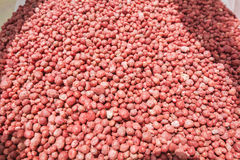 Fertilizer, red balls Royalty Free Stock Image