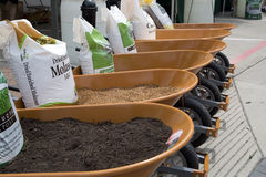 Fertilizer and soil for sale at street festival. Fertilizer and soil being sold at a festival surrounded by shops and restaurants at the Shops at Legacy in Plano stock photography
