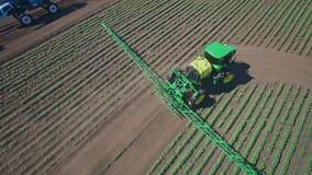 Agricultural sprayer irrigating on farming field. Fertilizer spreader stock video