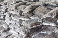 Fertilizer stacked bag. Fertilizer in plastic bags stacked layers Stock Photo