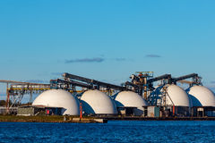 Fertilizer terminal. In Riga, big white storage tanks Royalty Free Stock Image
