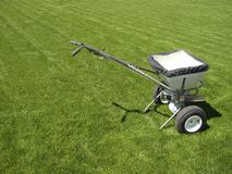 Fertilizer truck. On fresh cut green grass lawn Royalty Free Stock Photography