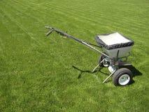 Fertilizer truck. On fresh cut green grass lawn royalty free stock photography