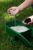 Fertilizing Lawn. Preparing to fertilize lawn in back yard in spring time Stock Photos
