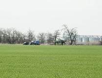 Fertilizing the tractor in the field. Refueling with herbicide.  Royalty Free Stock Photography