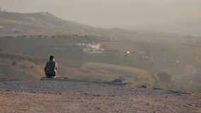 A Young Man Waiting. Fes City Overview. Morocco. North Africa. The young man is waiting for someone stock footage