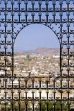 Fes, Morocco. Panoramic view of Fes (Morocco) through an ornamental window Stock Image