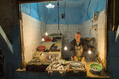 FES, MOROCCO, April 15: Unkown man selling fish in traditional s Royalty Free Stock Photos