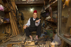 FES, MOROCCO, April 19: Unkown man selling wood materials in tra Royalty Free Stock Photos