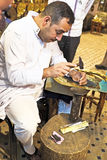 FES, MOROCCO - OCTOBER 17, 2013: Man making antique arabic handi Royalty Free Stock Photo
