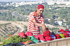 FES, MOROCCO - OCTOBER 17, Moroccan trader with his handmade mer Stock Photo