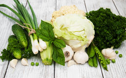 Fesh green vegetables. On a old wooden background royalty free stock photos