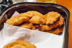 Fesh homemade schnitzels. Fesh golden homemade schnitzels in a pan stock photos