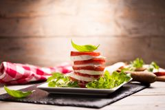 Fesh Italian Caprese. Salad with sliced mozzarella and herbs royalty free stock image