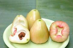 Fesh monkey apple. With banana leaf background royalty free stock photo