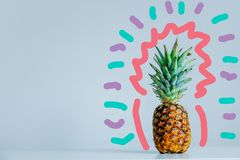 Fesh pineapple on table on gray background. With 90s art royalty free stock photography