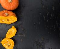 Fesh Pumpkin close-up shot. On a vintage slate slab stock photos