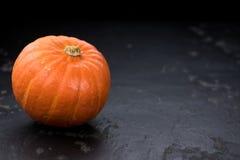 Fesh Pumpkin close-up shot. On a vintage slate slab royalty free stock photos